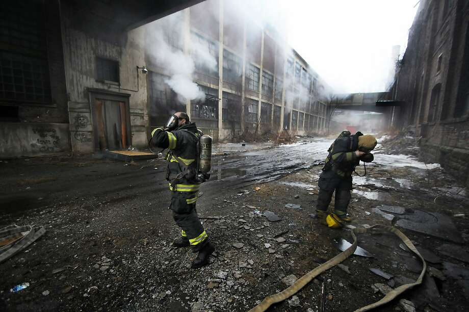 Scranton firefighters prepare to enter the former Scranton Lace Company building during a fire on Wednesday, March 19, 2014, in Scranton, Pa. No one was injured. The fire is still under investigation. (AP Photo/The Scranton Times-Tribune, Butch Comegys) MANDATORY CREDIT Photo: Butch Comegys, Associated Press