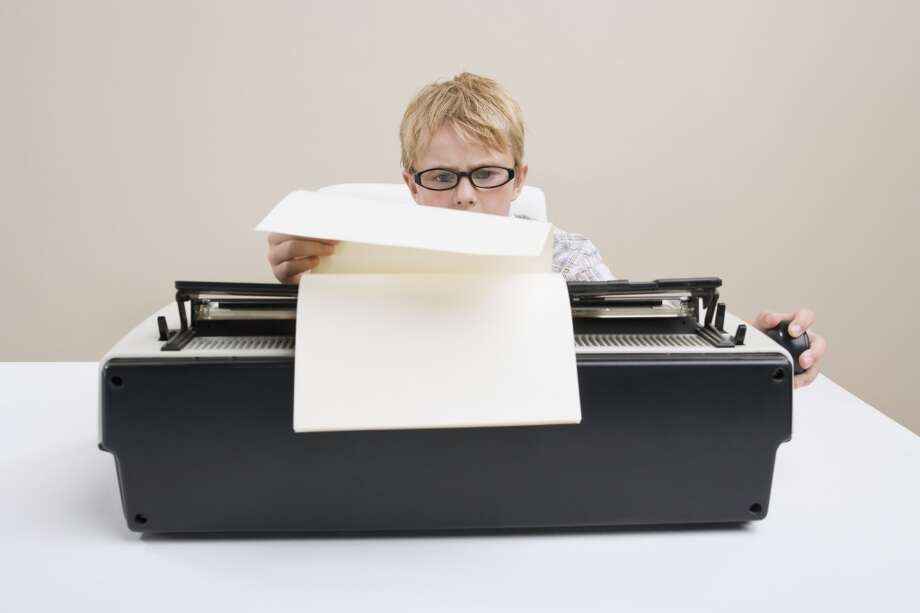 Type up a report on a typewriter. Photo: Darrin Klimek, Getty Images