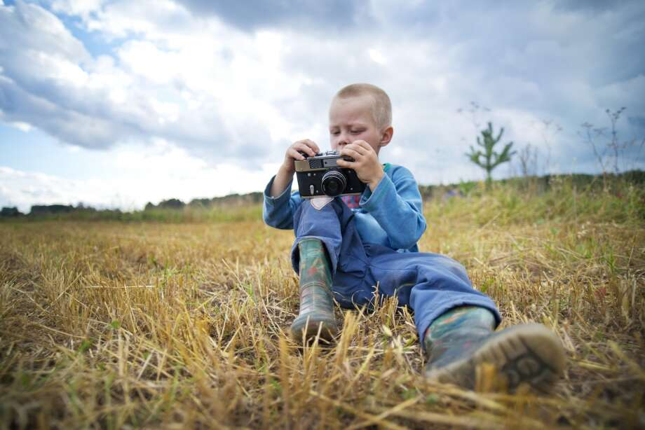 Take photos with a film camera. Photo: Cavan Images, Getty Images