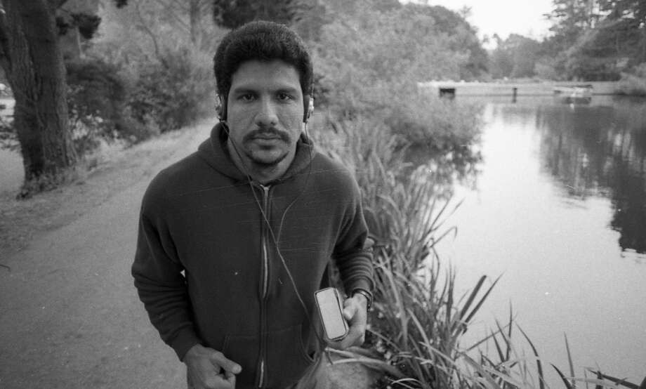 """Wearing headphones in Golden Gate Park. Early Walkman covers were made of thick leather, so it looked like you were jogging with a copy of """"War and Peace,"""" or a small VCR. Photo: Gary Fong, The Chronicle"""