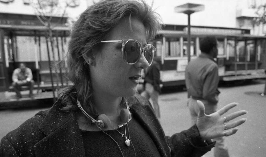 This woman achieves the 1980s trifecta, with the Walkman, Ray-ban knockoffs and heavily shoulder-padded jacket. Photo: Gary Fong, The Chronicle