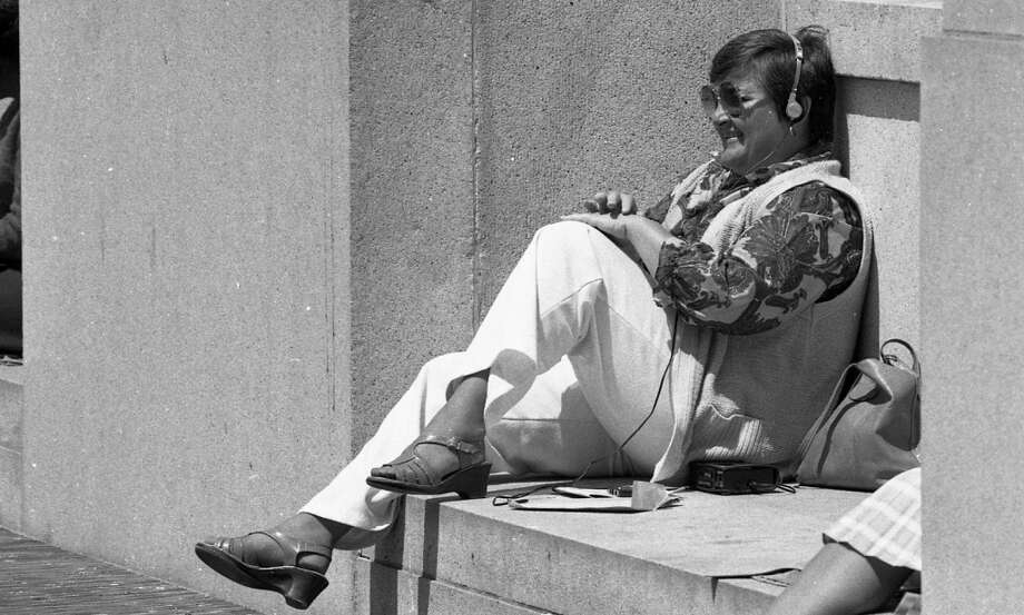 Listening to a Walkman near the federal building in San Francisco. Bonus 1980s points for wearing Candies. Photo: Gary Fong, The Chronicle
