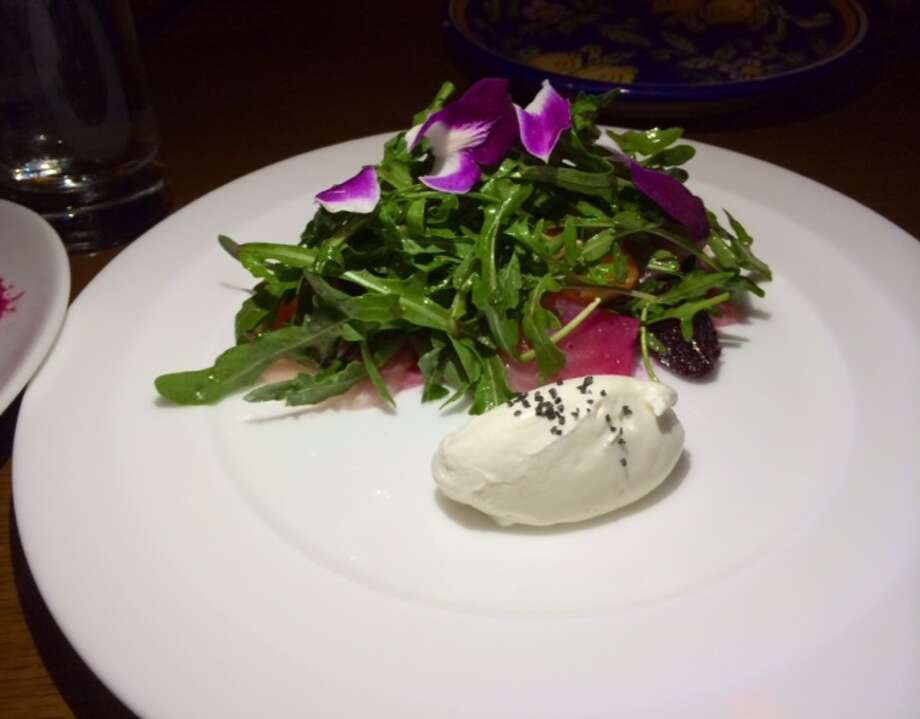 Salad with beets, clementines and chevra crema with coriander vinaigrette ($14)
