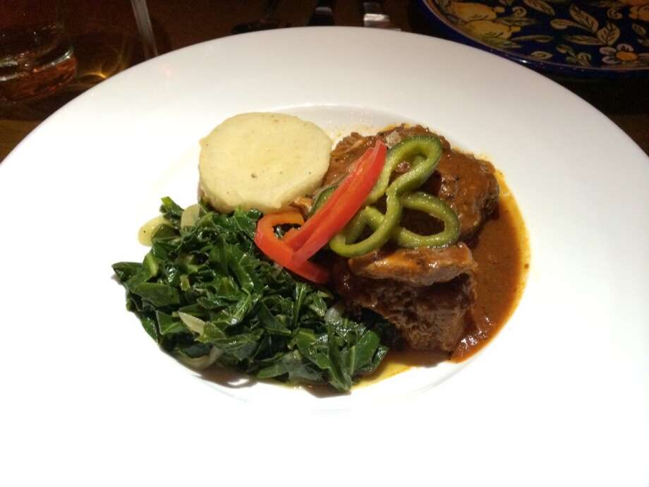 Braised pork shoulder with polenta cake, greens and peppers ($27)