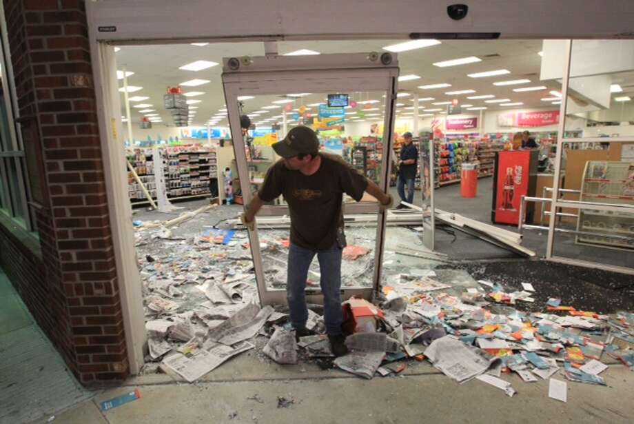 An unidentified suspect made a mess of a CVS at FM 1960 and Terrace Oaks Drive. Photo: Cody Duty, Houston Chronicle