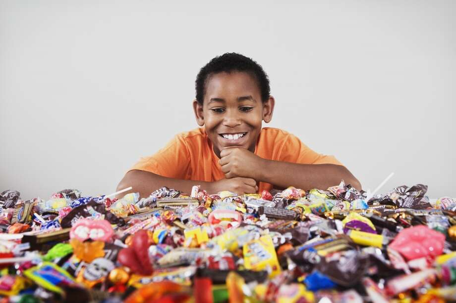 Eat all the Halloween candy. Today's parents often pay their kids to toss their pile of sweets. Photo: Jupiterimages, Jupiterimages / Getty Images