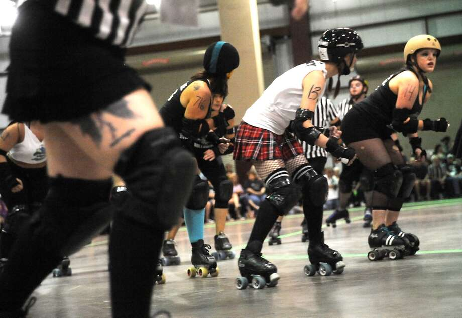 The Spindletop Roller Girls take on the Acadiana Good Times Rollers during the Spindletop Roller Girls first bout of the first season at Ford Exhibit Hall in Beaumont, Sunday. Tammy McKinley/ The Enterprise Photo: Tammy McKinley/ The Enterprise