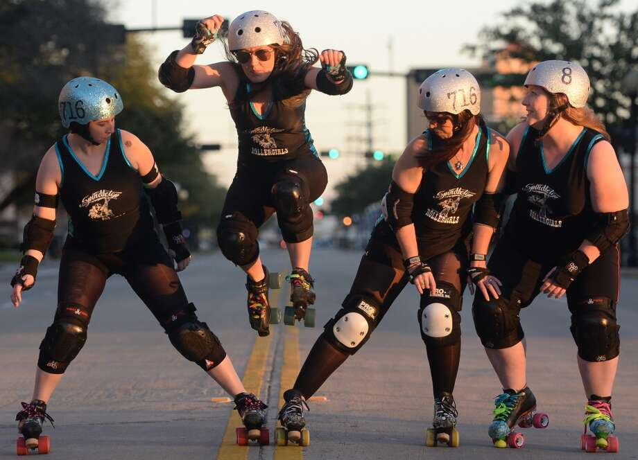 From left, The Spindletop Roller girl's  Stephanie Colwell, Rusty Landers, Sheri Ford. and Valerie Breaux demonstrate roller derby in downtown Beaumont.   Photo taken Wednesday, March 12, 2014 Guiseppe Barranco/@spotnewsshooter
