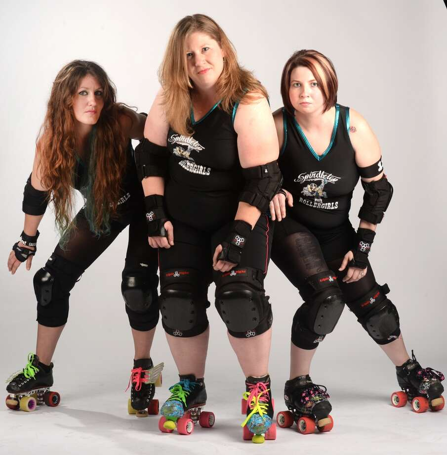 From left, The Spindletop Roller girl's Rusty Landers, Valerie Breaux and Stephanie Colwell. Photo taken Wednesday, March 12, 2014 Guiseppe Barranco/@spotnewsshooter