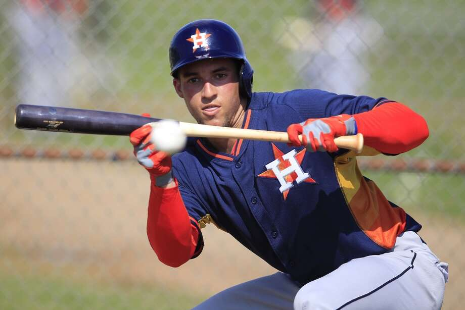 Springer bunts during workouts at camp in Kissimmee, Fla. Photo: Karen Warren, Houston Chronicle