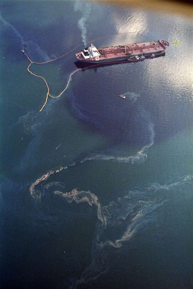 In April 1989, crude oil from the tanker Exxon Valdez (top) swirls on the surface of Alaska's Prince William Sound near Naked Island. The 987-foot tanker, carrying 53 million gallons of crude, struck Bligh Reef at 12:04 a.m. on March 24, 1989, and within hours unleashed an estimated 10.8 million gallons of thick, toxic crude oil into the water. Storms and currents then smeared it over 1,300 miles of shoreline. Twenty five years later, the region, its people and its wildfire are still recovering. Photo: John Gaps III, ASSOCIATED PRESS
