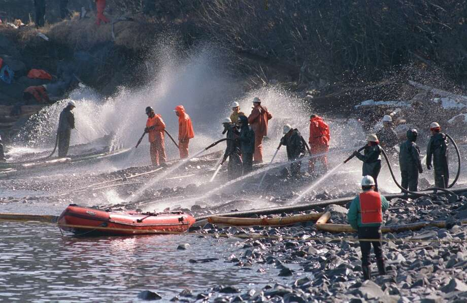 In April 1989, crews use high pressured hoses to blast the rocks on this beach front on Naked Island, Alaska. This is one of only two beaches that are being worked on, of the 58 beaches in the Prince William Sound.  On March 24, the crude oil tanker Exxon Valdez grounded on a reef and spilled nearly 11 million gallons of oil in the waters. Nearly 25 years after the Exxon Valdez oil spill off the coast of Alaska, some damage heals, some effects linger in Prince William Sound. Photo: Rob Stapleton, AP