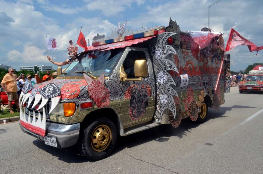 The Houston Art Car Parade makes Houstonians happy, and sometimes inspires us to start gluing junk on our own cars. Photo: Mike Herrera, --