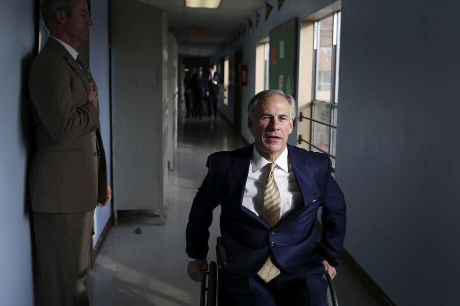 Attorney General Greg Abbott makes his way through a hallway at KIPP Camino Academy after visiting the school and meeting with KIPP administrators in San Antonio on Wednesday, Dec. 11, 2013. Photo: SAN ANTONIO EXPRESS-NEWS