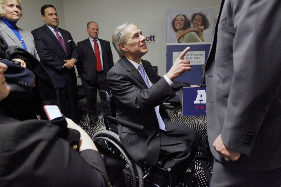 Texas Republican candidate for governor, Greg Abbott, greats supporters, Tuesday, Feb. 4, 2014  in Dallas. Republican Greg Abbott pledged Tuesday to double border security spending if elected Texas governor while deflecting talk of Democratic opponent Wendy Davis and her scrutinized biography that has dominated the race in recent weeks. (AP Photo/The Dallas Morning News, Mona Reeder)  MANDATORY CREDIT; MAGS OUT; TV OUT; INTERNET USE BY AP MEMBERS ONLY; NO SALES Photo: Associated Press