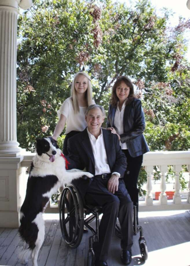 To The Dogs: Greg Abbott and his family and his dog, Oreo. Photo: Courtesy Photo