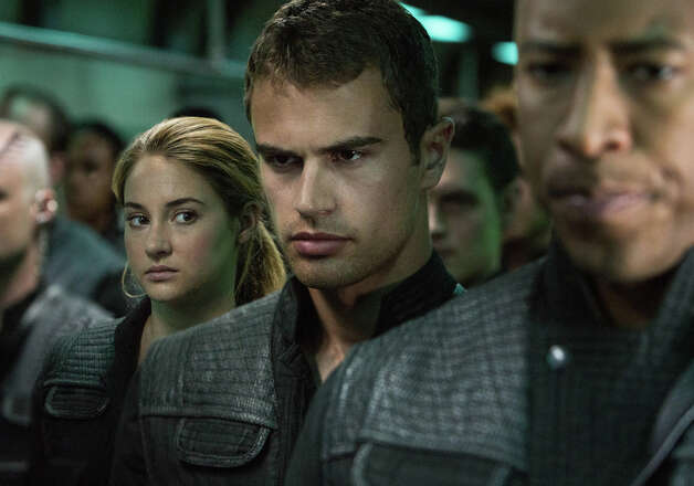 "Theo James, center, stars as Four in ""Divergent."" Photo: Jaap Buitendijk, HOEP / Summit Entertainment"