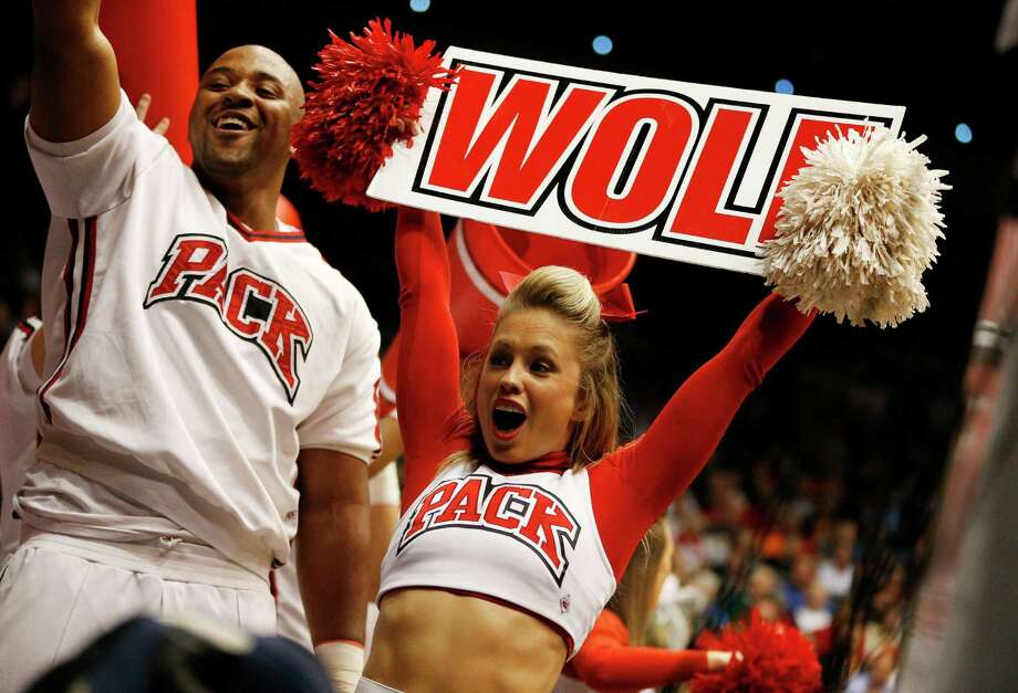 DAYTON, OH - MARCH 18:  North Carolina State Wolfpack cheerleaders perform in the first half against the Xavier Musketeers during the first round of the 2014 NCAA Men's Basketball Tournament at at University of Dayton Arena on March 18, 2014 in Dayton, Ohio. Photo: Gregory Shamus, Getty Images / 2014 Getty Images