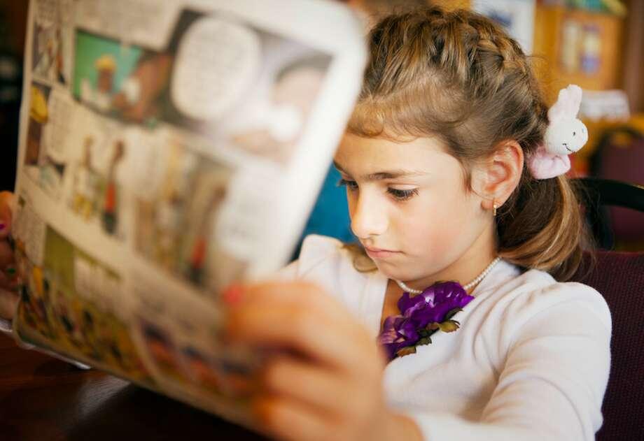 Read a newspaper. Photo: Getty