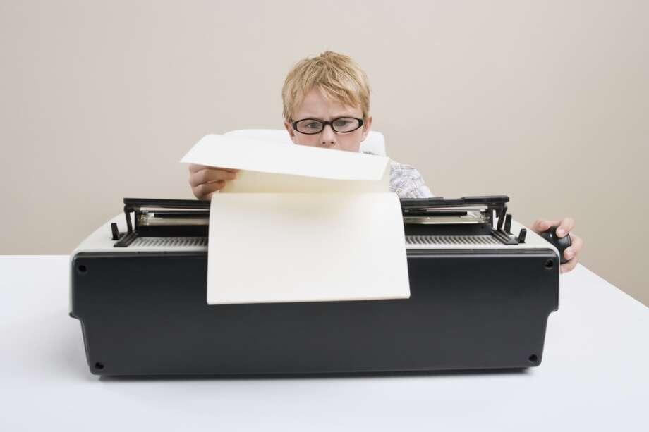 Type up a report on a typewriter. Photo: Darrin Klimek, Darrin Klimek / Getty Images