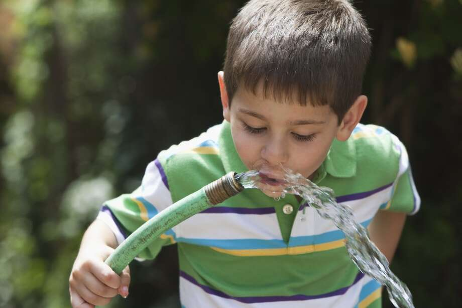 Drink water from a garden hose. Lead, BPA...the list of harmful chemicals in these hoses goes on and on. Photo: KidStock, Getty Images/Blend Images