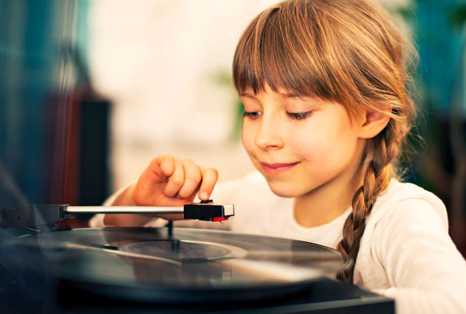 Listen to music on a record player. And we should probably add, listen to music on a cassette tape. Photo: Getty