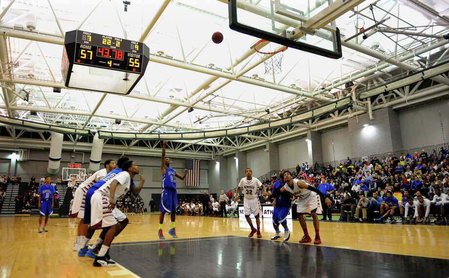 Bunnell's isaac Vann attempts to catch up with Windsor with a foul shot, during Class L boys basketball semifinal action against Windsor at the Floyd Little Athletic Center in New Haven, Conn. on Tuesday March 18, 2014. Photo: Christian Abraham / Connecticut Post