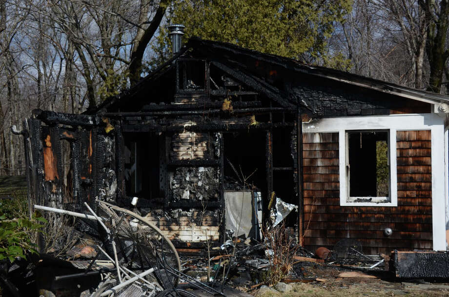 A caretaker's cottage at 301 Michigan Road in New Canaan was damaged in a fire Wednesday night. Fire Marshal Fred Baker said no one was home at the time and no injuries were reported. Jeanna Petersen Shepard / For the New Canaan News March 20, 2014 Photo: Jeanna Petersen Shepard, Freelance Photo / New Canaan News freelance