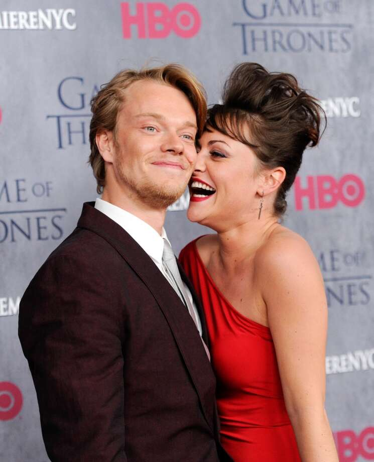 "Actor Alfie Allen and fiancé Jaime Winstone attend HBO's ""Game of Thrones"" fourth season premiere at Avery Fisher Hall on Tuesday, March 18, 2014 in New York. Photo: Evan Agostini, Associated Press"