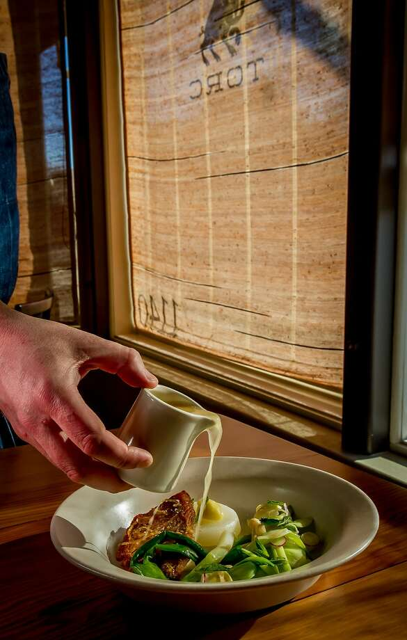 Citrus broth gets poured over the tai snapper at Torc in Napa, giving it a refreshing touch. Photo: John Storey, Special To The Chronicle