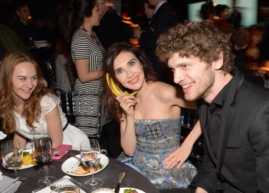 "Actress Carice van Houten, center, and friends attend HBO's ""Game of Thrones"" fourth season premiere after party at the Museum of Natural History on Tuesday, March 18, 2014 in New York. Photo: Evan Agostini, Associated Press"