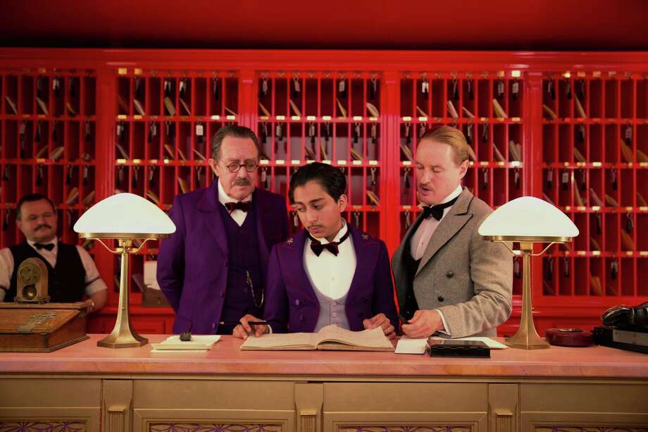 "This image released by Fox Searchlight shows Tom Wilkinson, Tony Revolori, center, and Owen Wilson, right,  in ""The Grand Budapest Hotel ."" (AP Photo/Fox Searchlight) ORG XMIT: NYET501 Photo: Martin Scali / Fox Searchlight"