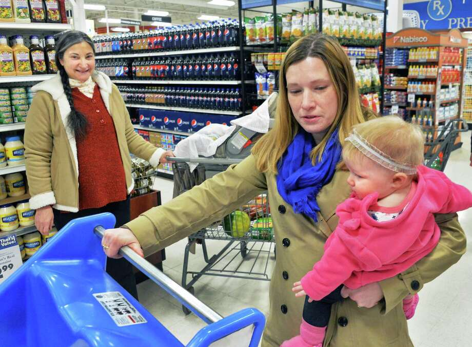 """H""'s star Robin Bartlett, left, watches as movie extra Amy Goggin of Troy and her 8-month-old daughter Emme get ready for to film a scene Thursday, March 13, 2014, in the Brunswick Plaza Price Chopper in Troy, N.Y.  (John Carl D'Annibale / Times Union) Photo: John Carl D'Annibale / 00026128A"