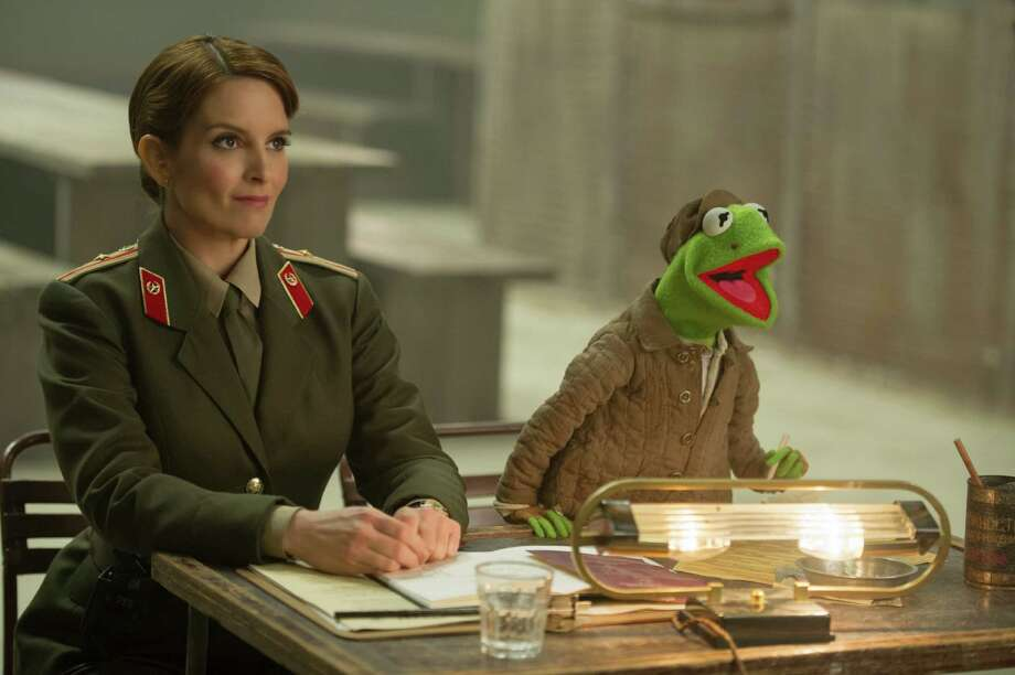 "This image released by Disney shows Tina Fey, left, and Kermit the Frog in a scene from ""Muppets Most Wanted."" (AP Photo/Disney, Jay Maidment) ORG XMIT: NYET546 Photo: Jay Maidment / Disney"