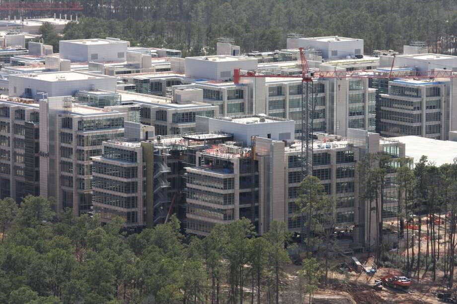 February 2014: The new Exxon Mobil corporate campus is under construction near The Woodlands. The new development is near Interstate 45 and the Hardy Toll Road. In total, the complex will house 10,000 people when it opens in 2015. Photo: Ben Hafer