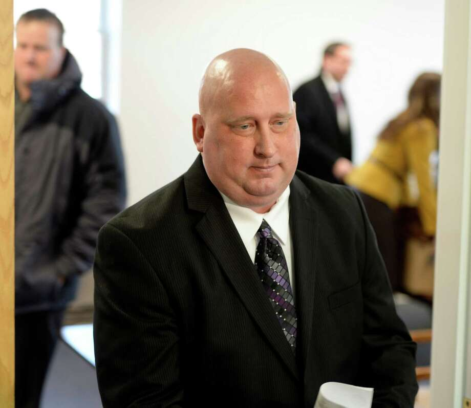 Albany Police officer Brian Lutz leaves Menands Town Court Thursday morning, Nov. 21, 2013, in Menands, N.Y. (Skip Dickstein/Times Union archive) Photo: SKIP DICKSTEIN / 00024742A
