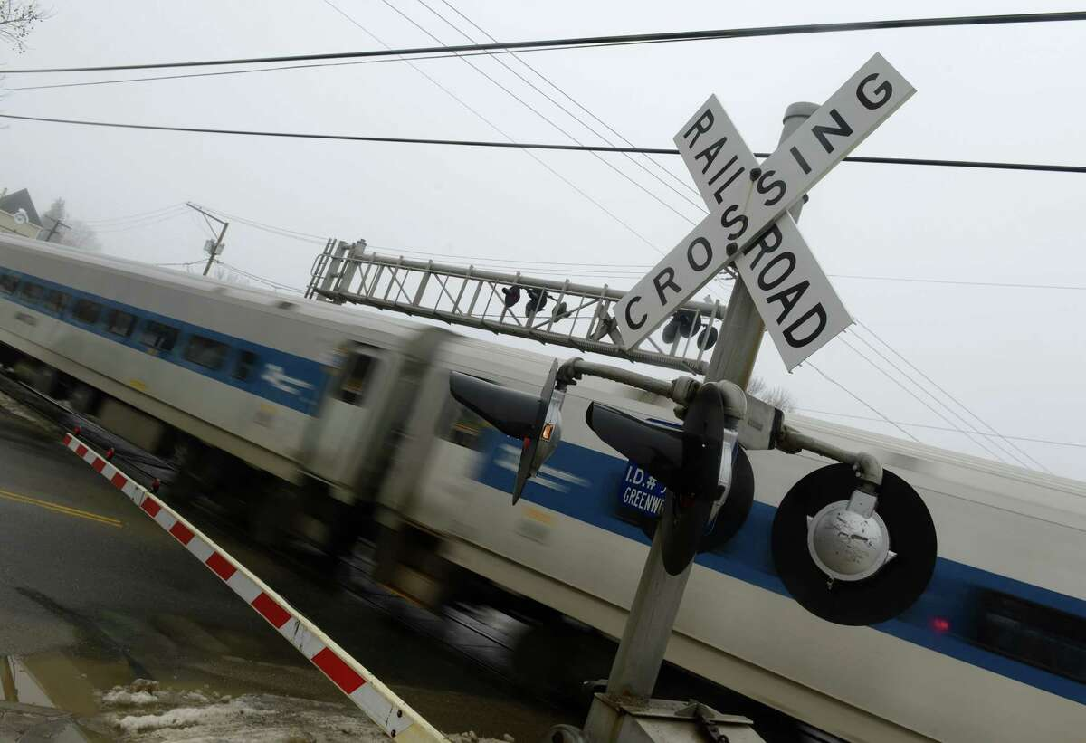 A Metro-North train bound for Danbury crosses Greenwood Avenue in Bethel, Conn. Friday, Feb. 21, 2014. There have been reports of problems with the lights and safety arms at the train crossing in Bethel.