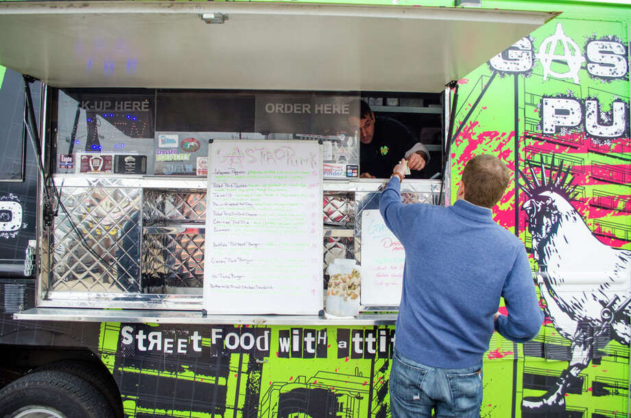 Sandy Shurin makes his lunchtime order at Gastro Punk Food Truck. Photo: Jamaal Ellis, For The Chronicle / ©2013 Houston Chronicle