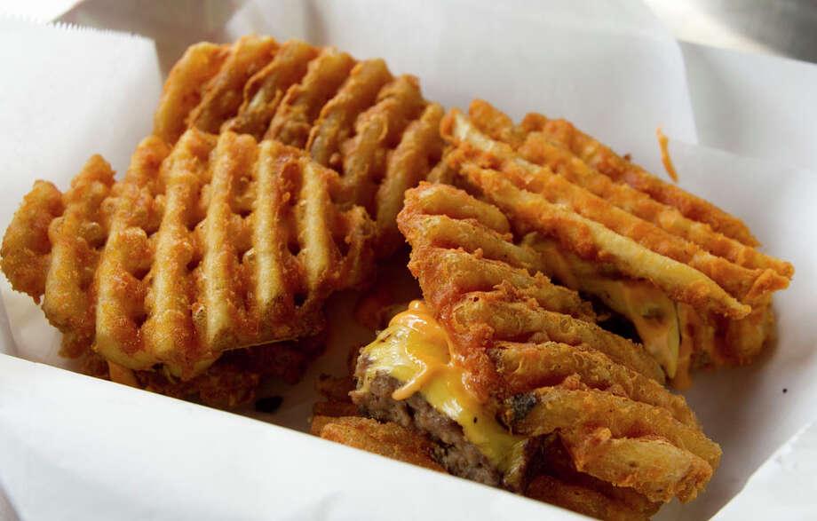 The Waffle Bus' Fryders (their take on sliders). Photo: Brett Coomer, Houston Chronicle / © 2012 Houston Chronicle