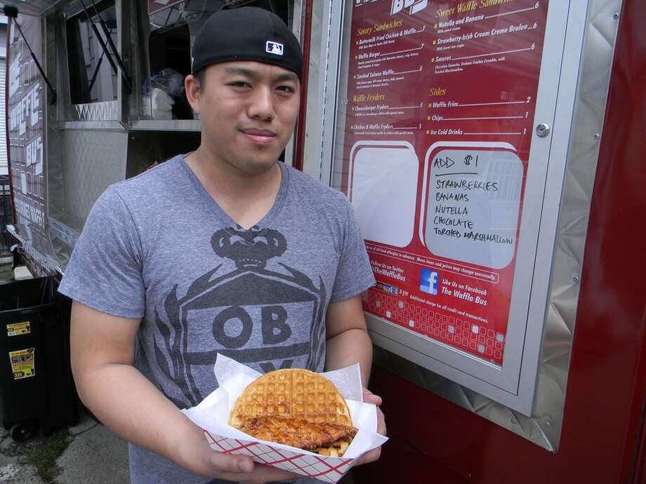 Phi Nguyen is the owner of the Waffle Bus, a food truck that serves Chicken and Waffle and Strawberry Irish Cream Cr me Brul e. Photo: Paul Galvani, For The Chronicle