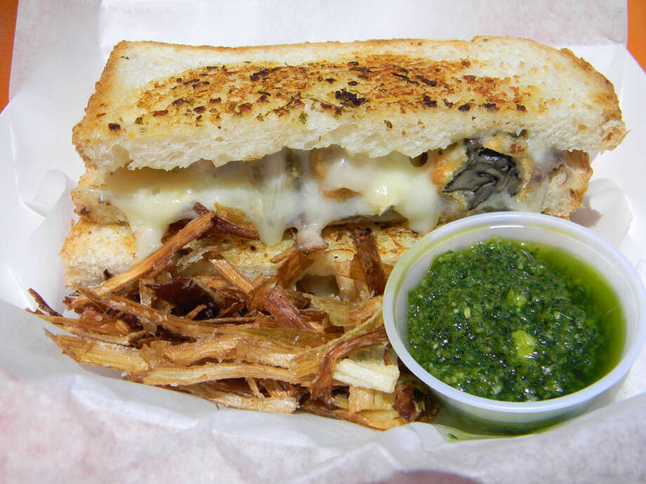 The Lady Bird food bus serves its Escargot Grilled Cheese Sandwich with fried leeks and a garlic and parsley dipping sauce. Photo: Paul Galvani, For The Chronicle