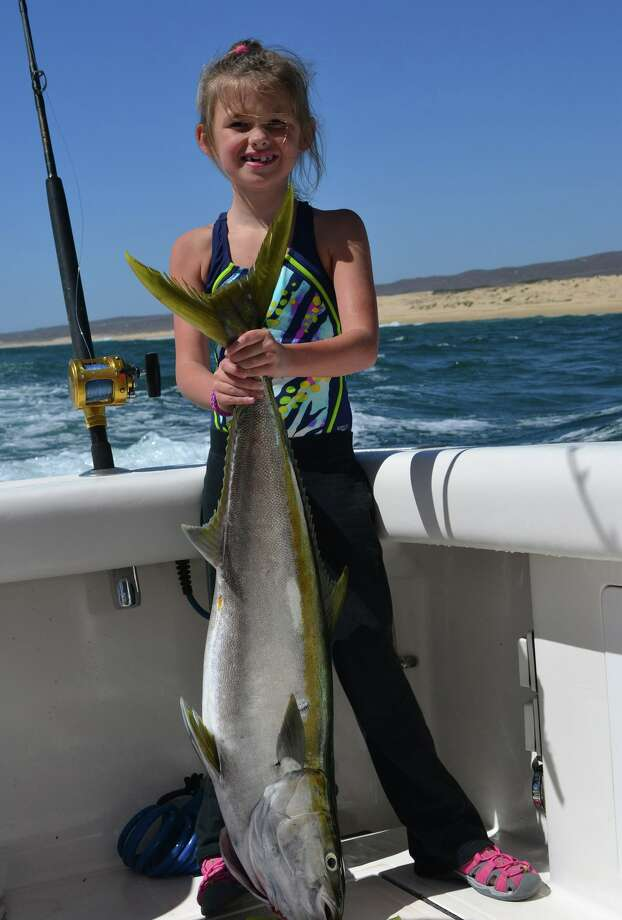 Layne Bulow with her biggest catch - a 33-pound yellowtail caught over spring break. (Julie Ferro)