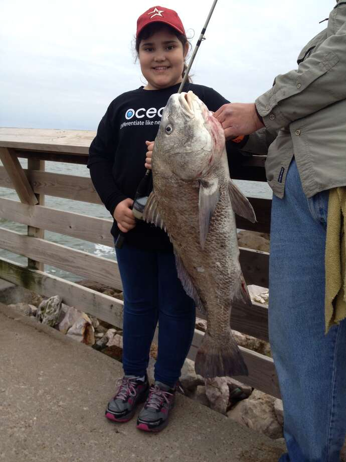 Iliana Aguilar on her first fishing trip with a black drum, caught on Sylvan Beach pier.