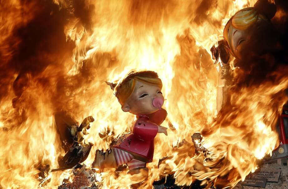 Bonfire of the dolls:Satirical sculptures and effigies go up in flames during the traditional Fallas festival in Valencia, 
