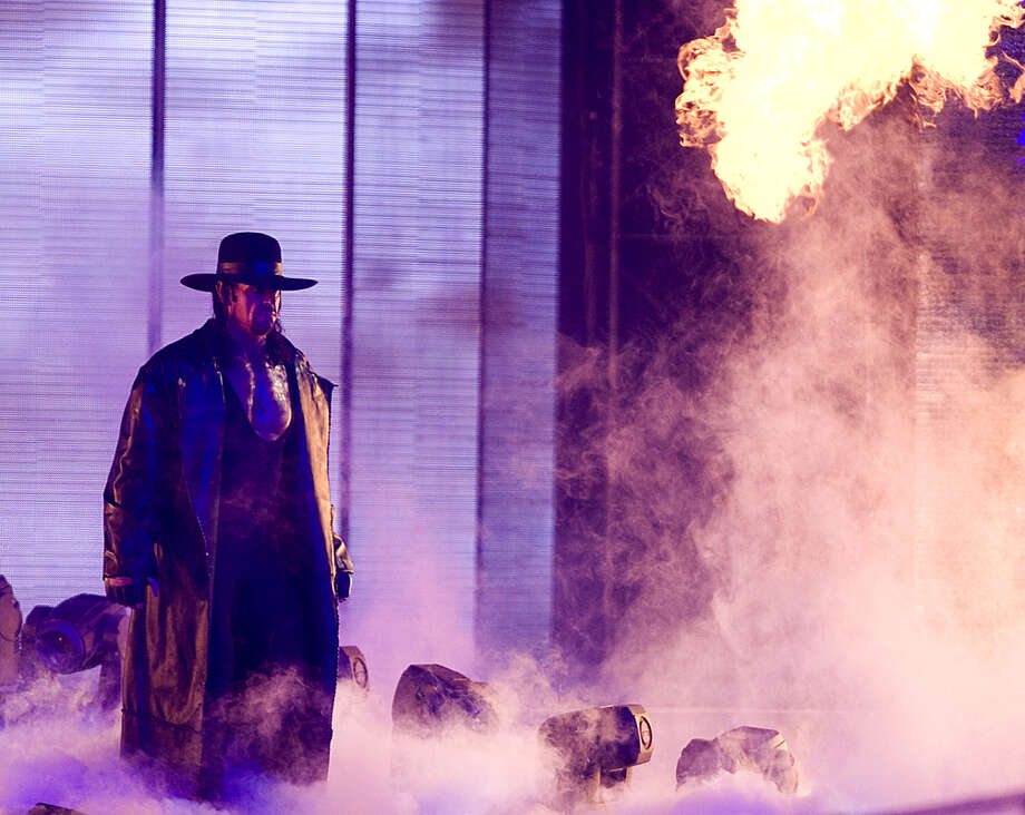 The Undertaker: Mark Calaway was born in Houston and played basketball before be became a wrestler in the mid-'80s. He started as Mean Mark Callous before developing the persona of the Undertaker, one of the most popular wrestlers of the past 30 years. Photo: Bob Levey, WireImage / 2009 Bob Levey