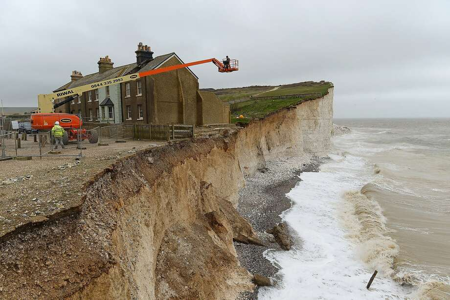 Doomed by cliff erosion,the last terrace cottage at Birling Gap awaits the bulldozer in   Eastbourne, United Kingdom. Photo: Mike Hewitt, Getty Images