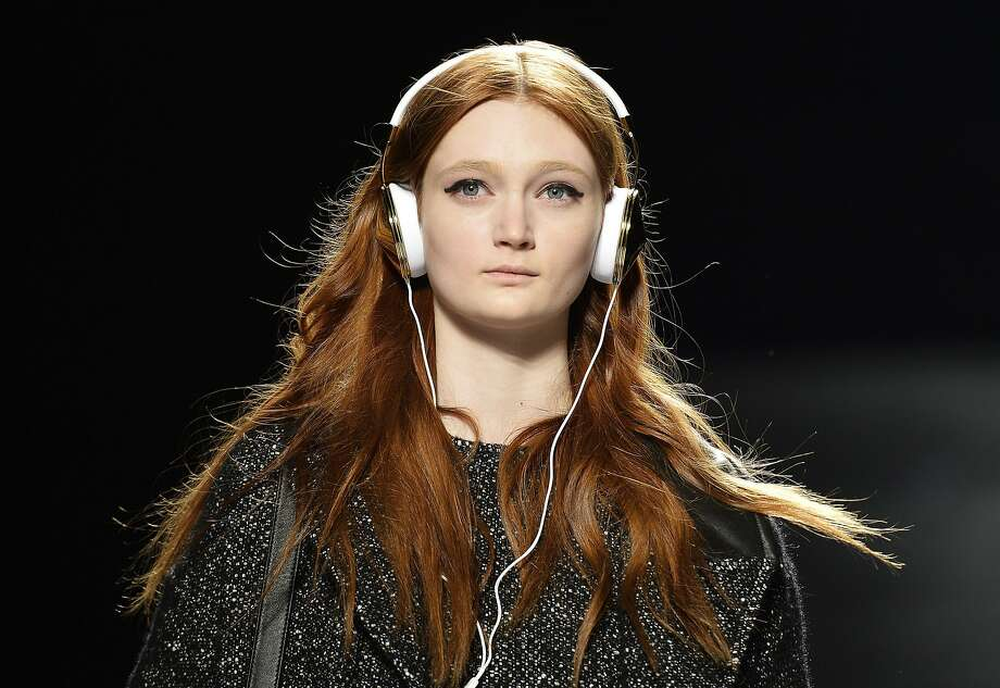 Totally understandable: Walking up and down the runway in different outfits all day can be pretty boring, so why not 