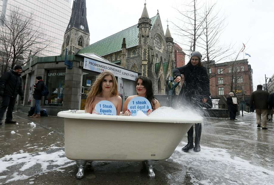 Share a bath, save the planet: PETA activists Nives Brkic and Chloe Kodrun sit in a bathtub to mark World Water Day and protest the eating of meat in downtown Montreal. Photo: Christinne Muschi, Reuters