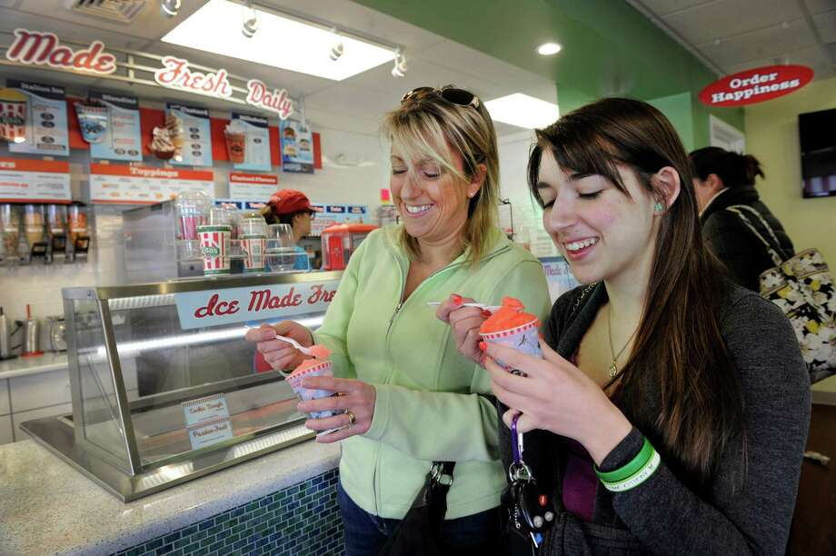 Jane Giambruno, left, and daughter, Jill Giambruno of Bethel, Conn., eat Italian ice at Rita's Italian Ice in Bethel, Thursday, March 20, 2014. Photo: Carol Kaliff / The News-Times