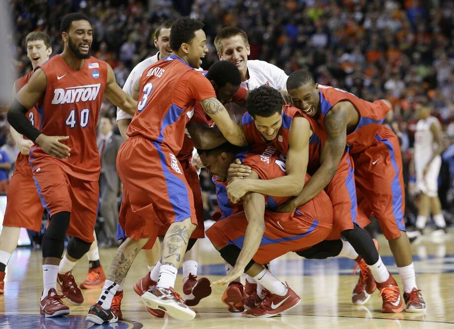 Dayton players start the dog pile after winning the battle of Ohio - beating Ohio State. Photo: Frank Franklin II, Associated Press
